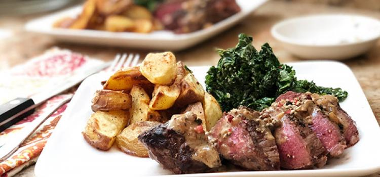 Crushed Peppercorn Steak with Creamed Kale and Potato Wedges